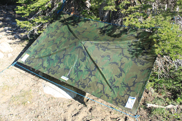 The Brooks-Range Ultralite Solo Tarp in camo.