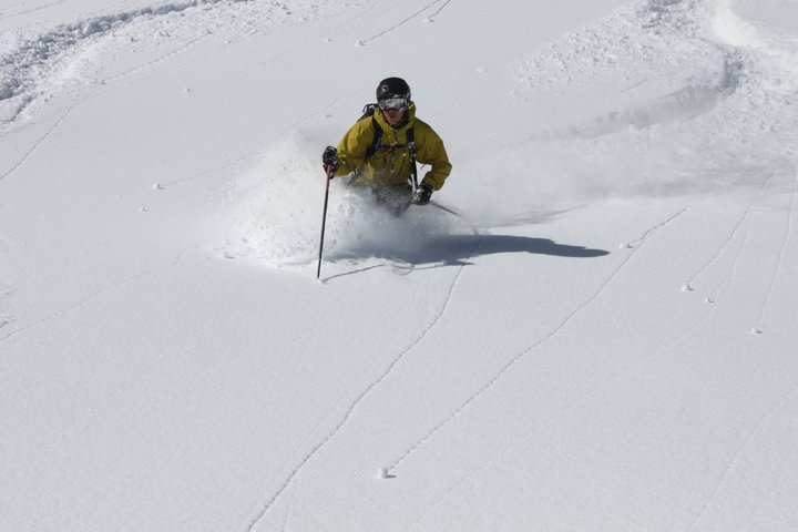 Skier's day of fresh powder are numbered. Get your turns in before resorts close in April. Skier: Mike Debernardo at Alta.