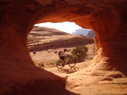 View of the trail from Pothole Arch near Amasa Back, Moab. Rider: Jared Anderton.