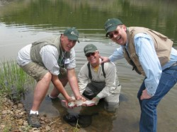 Men show off their catch at the Reel Recovery event at Altamont, Utah in 2011. (Image courtesy Reel Recovery)
