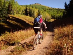 Mason Diedrich bikes the Great Western Trail in Mill Creek Canyon where transportation is once again an issue. (Photo: Jared Hargrave - UtahOutside.com)
