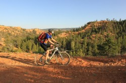 Mason Diedrich rides past an overlook on the Cassidy Trail in Red Canyon. (Photo: Jared Hargrave - UtahOutside.com)