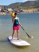 The author tries standup paddle boarding, or SUP at the Outdoor Retailer 2012 Open Air Demo.