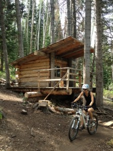 An unidentified mountain bikers rides past a warming hut on the Team Big Bear Trail at Deer Valley. (Photo: Jared Hargrave - UtahOutside.com)