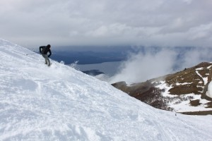 Adam Symonds skis on the edge of Cerro Catedral, Patagonia. (Photo: Jared Hargrave - UtahOutside.com)
