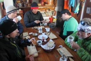 Breakfast inside Refugio Frey. Pictured from left to right: Sean Zimmerman-Wall, Justin Lozier, Adam Symonds, Chad Burt and Wes Wylie. (Photo: Jared Hargrave - UtahOutside.com)