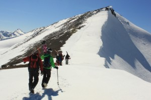 The group boot packs to the summit of Cordera de los Hermanos for a second descent of the peak. (Photo: Jared Hargrave - UtahOutside.com)
