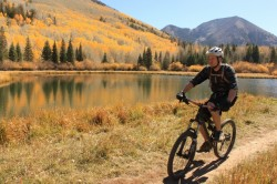 A mountain biker pedals alongside the postcard scenery of Warner Lake in the La Sal Mountains. (Photo: Jared Hargrave - UtahOutside.com)