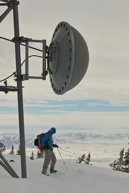 Adam Symonds on top of Logan Peak, beneath the giant communications tower. (Photo: Jared Hargrave - UtahOutside.com)