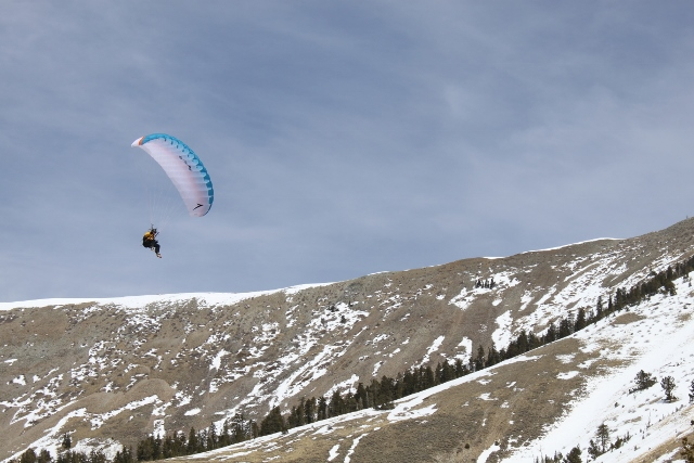Jon Strickland goes for a long ride in the air above the South Summit - Henry Mountains, Utah. (Photo: Jared Hargrave - UtahOutside.com)