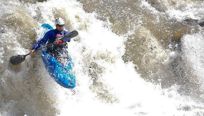 Aaron Pruzan paddles over Grace Falls (Photo: Bryson White, utahoutside.com)