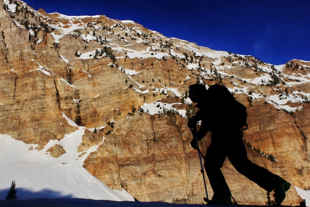 Sean Zimmerman-Wall is a shadow as he skins below the summit cliffs of Deseret Peak. (Photo: Jared Hargrave - UtahOutside.com)