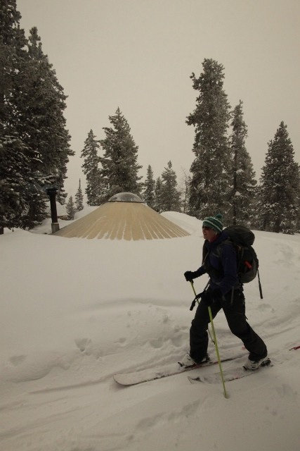 Lexi Dowdall skins past the buried Castle Peak Yurt in the Uinta Mountains. (Photo: Jared Hargrave - UtahOutside.com)