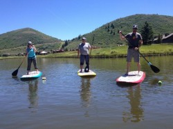 Standup Paddleboarding is a fun workout on the lake, plus it's easy to learn on the calm water at Deer Valley. (Photo: Callista Pearson - UtahOutside.com)
