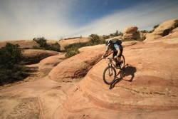 Photo John rolls over slickrock on Little creek Mesa as part of the Hurricane Mountain Bike festival. (Photo: Jared Hargrave - UtahOutside.com)