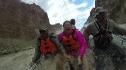 Video still from a GoPro in the Big Drop rapids of Cataract Canyon. Adam Eakle, Shara Paek and Ty Hunter all come up for air after getting a bath in the Colorado River.