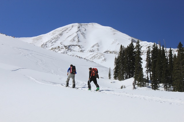Mount Tukuhnikivatz is a spectacular peak to ski for spring corn harvests in the La Sal Mountains. Here, Adam Symonds and Justin Lozier skin up Gold Basin en route to the peak. (Photo: Jared Hargrave - UtahOutside.com)