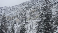 A chairlift is covered in powder in Little Cottonwood Canyon after a freak September storm (Photo: SkiUtah)